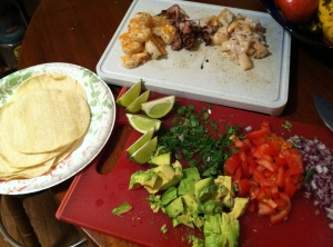 Red onion, tomato, cilantro, avocado, limes, seafood, and corn tortillas