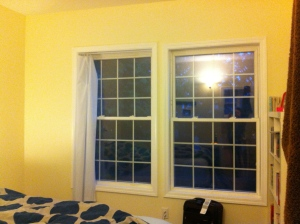 The window on the left is about an inch taller…bizarro. And yes, that is a WHITE shower curtain in one of the windows.