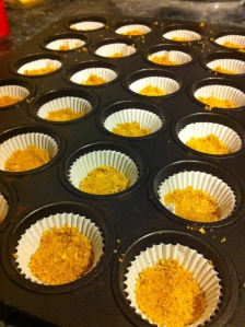 Make your graham cracker crust, and put about a teaspoon full into each mini-muffin liner. Press to flatten.