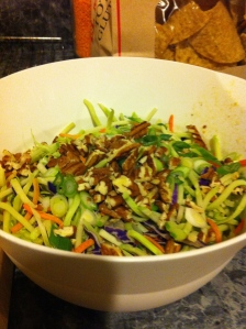 Broccoli slaw with pecans and scallions.