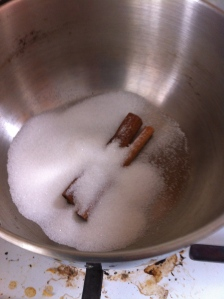 In a small saucepan, put 2 cinnamon sticks and 2 TBS of granulated sugar.